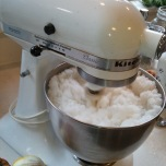 It takes about 8 cups of sugar to fill my trusty mixer